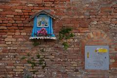 IMGP4983 Sacred and profane (Claudio e Lucia Images around the world) Tags: venice venezia pentaxk3ii pentaxcamera pentaxart veneto murale street art graffiti graffito murales pentaxlens pentax18135 blue stencil poster streetart wall muro decoration eyes maria madonna bricks sacred profane