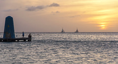 Watching sunset (mystero233) Tags: sunset sun dusk aruba onehappyisland island beach boat water sea caribbean dadson outdoor landscape yellow clouds sky relax holiday
