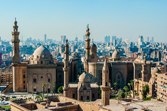 Mosque Madrassa of Sultan Hassan photo, panoramic view from fortress (www.capacitymedia.com) Tags: cairo egypt downtown islam street medieval town travel view mosque citadel urban landmark panoramic sultan skyline old africa rifai minaret building hassan egyptian architecture city plant alrifai scenic saladin house religion ancient scene royal madrassa palm muslim madrasa landscape cityscape russianfederation