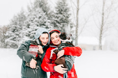 Merry Christmas (Rebecca812) Tags: winter weather snowing snow outdoors trees children child girl boy sister brother red white puppy frenchbulldog bostonterrier dogsweater sweater coats warmclothing humor cute whitechristmas happiness love togetherness friendship people portrait candid