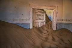 For dust we are and into dust we shall return (Kevin Rheese) Tags: africa ghosttown abandoned interior decay derelict namibia kolmanskop room sand haunted door karasregion na