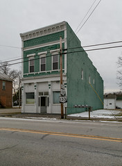 Building — Clarksville, Ohio (Pythaglio) Tags: building structure historic twostory brick painted colorful italianate cornice brackets clarksville ohio clintoncounty sidewalk storefront 11windows rusticated stone lintels sills stampedmetal metal pressedmetal altered