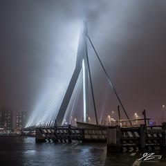 Sailing Through (TVZ Photography) Tags: 1x1 square erasmusbrug bridge architecture cloud city river water reflection rotterdam netherlands holland night evening longexposure lowlight sonya7riii zeiss loxia 21mm