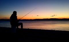 Fishing at Sunset (missgeok) Tags: sunset merimbula saphhirecoast wharf newsouthwales australia fishingatsunset fishing outdoor sky water colours beautiful lovethisplace vacation hobby recreation fishingline lone fisherman silhouette