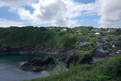 3K002970a_C (Kernowfile) Tags: cornwall cornish pentax cornishharbours sea water sky bluesky harbour boats reflections grass cottages houses beach clouds bush tree rocks cliffs pebbles thetodden