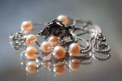 pearls for my silver pig (marinachi) Tags: macromondays jewelry pearls silver pig pendant silverchain macro closeup sundaylights