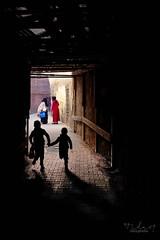 Au coin de la rue (Tilemachos Papadopoulos) Tags: qoq antiquity fuji fujifilm fujinon outdoor contrast street souk shadow silhouette kid xe2 candid colour colourful mirrorless medina morocco marrakech