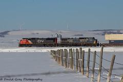 Fence Lines (Going Trackside Photography) Tags: canadian national railway canada alberta intermodal fence line cn rail cnr railroad wind turbine snow blue sky winter