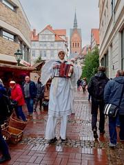 Angels at the Christmas Market (mikehaui60) Tags: akkordeon angel aufstelzen christmasmarket dmcg81 germany hannover kleinkunst lowersaxony lumix mft panasonic panasoniclumixdmcg81 streetfotography streetlife weihnachtsmarkt