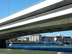 River Cruisers Under Bridge (mikecogh) Tags: vienna riverdanube donau boats tourism cruisers long bridge reichsbrucke concrete span