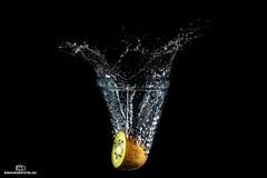 Kiwi fruit (einhundertstel.eu) Tags: kiwi fruit water splash drops black green diving food