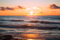 Lake Michigan Sunrise (Schwaco) Tags: door county wisconsin lake michigan water waves sunrise glow orange red clouds cloudscape landscape laekscape waterscape sun dawn early morning rise up north shore beach sky