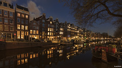 Amsterdam. (alamsterdam) Tags: amsterdam canal evening longexposure prinsengracht boats cars bridge bikes sky clouds architecture