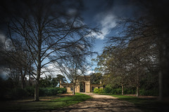 Gatehouse and Lodge (Ian Johnston LRPS) Tags: red drive gatehouse lodge osborne trees grass stones building sky clouds