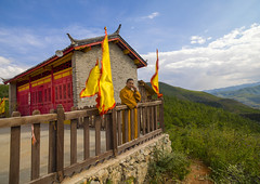 Monk Talking On Mobile Phone In Front Of Temple Over A Valley, Lijiang Area, Yunnan Province, China (Eric Lafforgue) Tags: a0007545 adult asia buddhism calling cellular china chineseculture clothing colorpicture communication horizontal mobilephone modernity monk monkreligiousoccupation onepeople oneperson outdoors realpeople robe talking telephone temple traditionalculture tranquilscene yunnan yunnanprovince lijiang