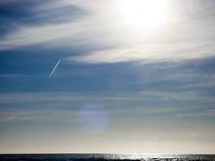 The Solar Explorer (Steve Taylor (Photography)) Tags: spaceship minimalism minimalist blue white odd strange newzealand nz southisland canterbury christchurch newbrighton sea pacific ocean lensflare autumn cloud sky rocket sun plane aeroplane aircraft