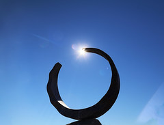 A Different Eclipse (studioferullo) Tags: art beauty bright colorful colourful colors colours contrast dark design detail edge light lines metal minimalism nopeople perspective pretty sky southwest study sunlight sunshine texture tone world tubac arizona sun sculpture eclipse ring circle round newby garden