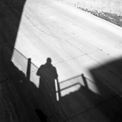 untitled (kaumpphoto) Tags: rolleiflex 120 tlr ilford bw black white street urban city shadow cement concrete minneapolis crack