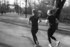 Zoom (Arne Kuilman) Tags: amsterdam nikon fm3a vivitar 28mm luckyshd iso100 id11 7minutes homedeveloped stock analogue film vondelpark women running movement jogging fitness