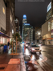 Wet Mission Street (20190322-DSC00569) (Michael.Lee.Pics.NYC) Tags: sanfrancisco missionstreet street rain wet reflection salesforcetower soma night architecture cityscape cars traffic sony a7rm2 zeissloxia21mmf28
