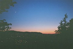Gloaming, Inverness, May 2016 (Mano Green) Tags: canon eos 300 40mm lens lomography colour negative 400 35mm film scotland uk may spring 2016 sky sunset dusk twilight gloaming moon city lights trees silhouette