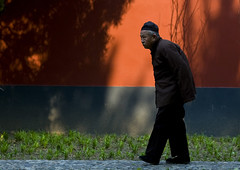 Old Chinese Man Walking, Beijing China (Eric Lafforgue) Tags: mg9896 adultsonly asia beijing bending china chinese colorpicture fulllenght hat horizontal old oldman oldpeople onepeople oneperson outdoor park pekin profile realpeople red sideview street travel unrecognizableperson