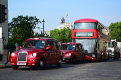 Cabs and a double decker bus in London... (Last Border of the Picture) Tags: london cab bus buses westminster taxi londoner 148 route street car red colour road bitumen