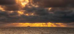 Sun rising over the North Sea on the North Norfolk Coast. (daveknight1946) Tags: norfolk sherringham northsea sunrise clouds sunrays