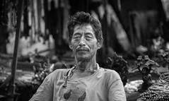 Bodh Gaya street merchant (andy_8357) Tags: sony a6000 alpha 6000 ilcenex ilce6000 mirrorless nikkor 105mm f25 ai portrait black white blanco y negro blanc et noir bw tibetan street merchant salesman sales bodh gaya buddhism mala man portraiture photography vintage prime