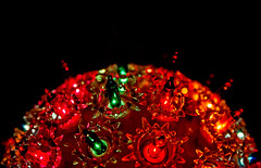 Lights from a round Christmas ornament on Christmas tree (CarmenSisson) Tags: alabama bayoulabatre christmas christmaslights christmasornament christmastree us usa unitedstates ball color colorful colour colourful decoration festive glow glowing holiday lights noone nopeople nobody onblack orb outdoors outside party red season seasonal mobile
