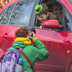 Smiling for the camera (Frank Fullard) Tags: frankfullard fullard candid street portrait color colour smile stpatrick parade irish ireland green hat red car boy mom photographer fun lol castlebar mayo