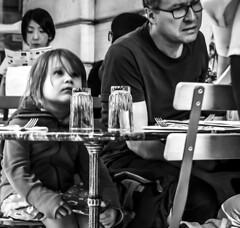 Girl looks up in Stockholm Sweden31/7 2016. (photoola) Tags: stockholm street sv barn servering monochrome blackandwhite sweden photoola girlchildren
