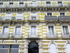 Royat-Chamalières, former Hotel Le Thermal (Sokleine) Tags: hotel letermal belleépoque immeuble building bâtiment façade jaune yellow windows fenêtres fenster ferronnerie ironwork sculptures mascarons têtes heads royat chamalières 63 puydedome auvergne frenchheritage france