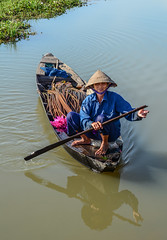 A woman with conical hat rowing boat (phuong.sg@gmail.com) Tags: aquatic asia asian blooming blossom boat circle colors cool country countryside delta dishes environment female floral flower green harvest harvesting horizontal lake leaf lily mekong nature outdoor person petal picks pink plant pond river row rowing rural sit summer vegetables vietnam vietnamese water waterlily wet woman wooden