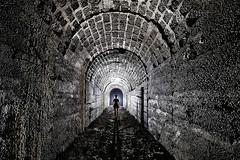 Galerie technique (flallier) Tags: carrière souterraine ciment underground cement quarry cimentprompt galerie galerietechnique tunnel silhouette backlight backlighting souterrain nikon d700 nikkor 20mm ais voûte maçonneries