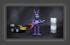'Five Nights at Freddy's' figure playing a Gibson Flying Vee guitar (N.the.Kudzu) Tags: tabletop toy fivenightsatfreddys miniature gibsonflyingvee guitar canondslr meike 85mmf28 macro lens canon430ex flash photoscape frame home