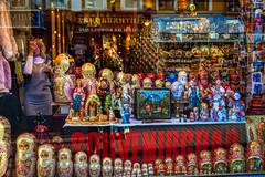 """Souvenirgrad"" store on Old Arbat street (Moscow, Russia) (KonstEv) Tags: moscow russia arbat store souvenir matryoshka toy wooden showcase storefront window reflection"