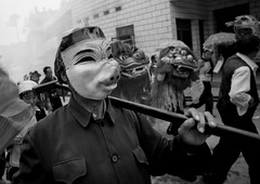 Man With A Pig Mask During A Funeral Procession, Yuanyang, Yunnan Province, China (Eric Lafforgue) Tags: a0006746 adultsonly asia china chineseculture colorpicture custom day death event funeral groupofpeople horizontal mask mourning outdoors parade pig realpeople religion taoism traditionalclothing traditionalculture unrecognizableperson yunnan yunnanprovince yuanyang