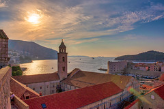 Glorious Sunrise (Shawn Harquail) Tags: church croatia dubrovnik religion shawnharquail sunset tower travel boat cloud clouds dock glow landscape lendsflare mountain outdoor roof rooftop seascape shawnharquailcom sky sunrise travelphotography