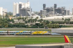 19-499 (George Hamlin) Tags: florida fort ft lauderdale international airport fll southwest airlines 737 boeing railroad passenger train brightline southbound buildings structures grass field photo decor george hamlin photography