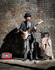 Busker London. (James-Burke) Tags: bricklane musician busker streetentertainer london guitarist street