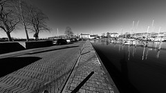 Along The Harbour (Alfred Grupstra) Tags: blackandwhite nauticalvessel harbor urbanscene outdoors architecture reflection water city pier sunset travel marina sky famousplace tourism sea street europe cityscape harbour