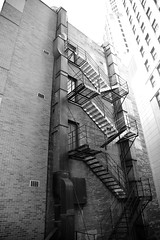 Escape from the City - Chicago 2019 (James J. Novotny) Tags: step steps door fireescape unlimitedphotos facade nikon d750 chicago citylife city cityofchicago bw buildings blackandwhite downtown