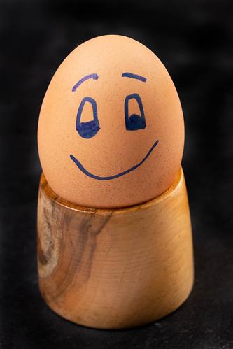 Happy Boiled Egg on the wooden holder