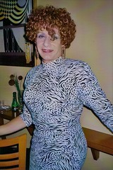Coming Out Of My Shell (From 2003) (Laurette Victoria) Tags: curly redhead animalprint woman laurette