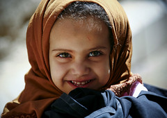 Little Yemeni Girl Smiling, Amran, Yemen (Eric Lafforgue) Tags: arabia arabiafelix arabianpeninsula broadsmile browneye child closeup colourpicture cute day girl happy horizontal innocence littlegirl lookingatcamera onegirl oneperson placeofinterest portrait realpeople smallteeth smile smiling sun woman yellowheadcover yemen yemeni younggirl youth mg6741 houthis amran