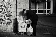 Paper Boy (Bury Gardener) Tags: monochrome mono burystedmunds bw blackandwhite britain suffolk streetphotography street streetcandids snaps strangers candid candids people peoplewatching folks nikond7200 nikon 2019 england eastanglia cornhill