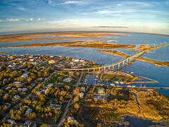 Apalachicola is a small Coastal Community on the Gulf of Mexico in Florida's Panhandle (JacobBoomsma) Tags: coastline see water cypresstrees dawn nature ocean dusk beautiful shoreline seen sky apalachicola blue travel morning horizon sand beach sunrise landscape seaside fishing states boat summer building town united south florida bay church sea pier old aerial above downtown winter