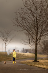 Boy and his dog; before the Storm (Manjinder Kaur Papial) Tags: explore rain fog minnesota boy sikh clouds nikkor manjinderkaurpapial dog umbrella