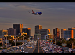 Soaring over San Diego (Sam Antonio Photography) Tags: freeway cars traffic travel sky california transportation tourism airplane landing jet airport aviation transport sunset destination sandiego lindberghfield aircraft pilot passengerjet flight speed vacation commercialairliner copyspace airtrafficcontrol aviationbackgrounds sandiegocalifornia airtraffic business city highway urban vacationdestinations finalapproach airtravel lindberghfieldcalifornia jettravel commercialaviation cityscape southwest airlines boeing 737